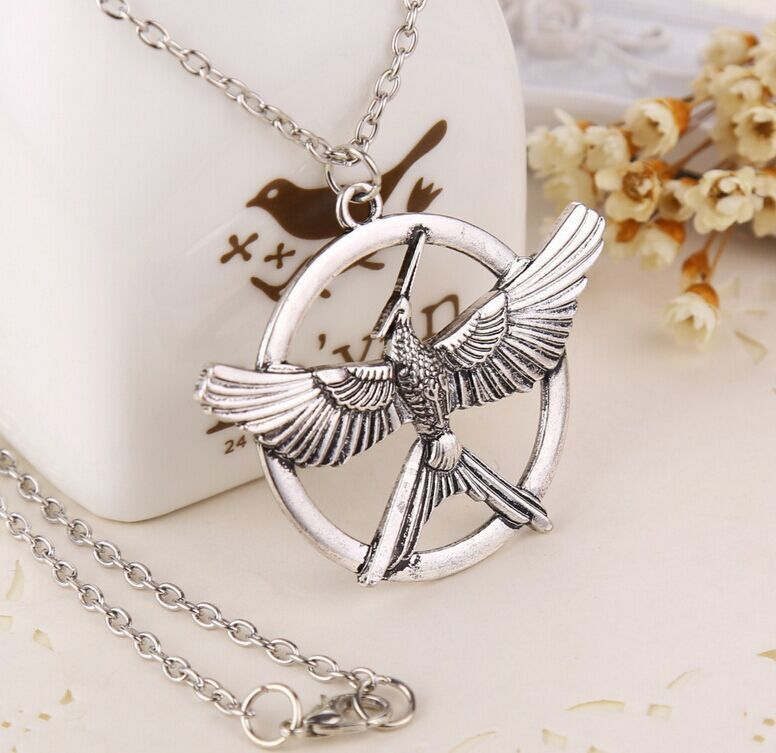 Get this the hunger games mockingjay pendant necklace and let the get this the hunger games mockingjay pendant necklace and let the world know youre aloadofball Images
