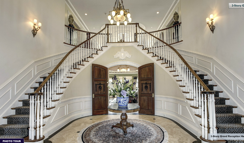 Mansion Foyer Chandelier : A beautiful butterfly staircase in the grand foyer of this