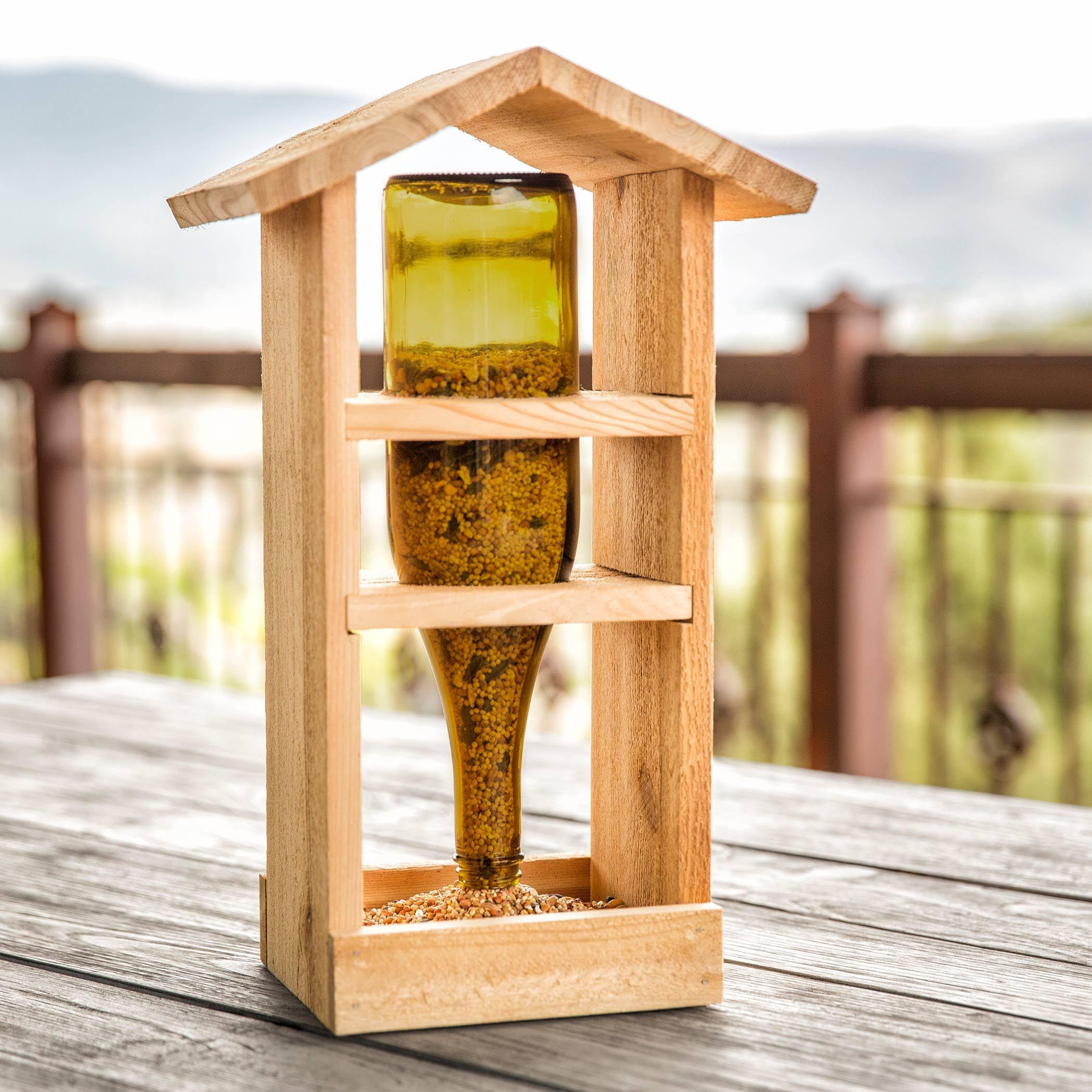 Homemade wooden bird feeders bird feeders pinterest for How to make homemade bird houses