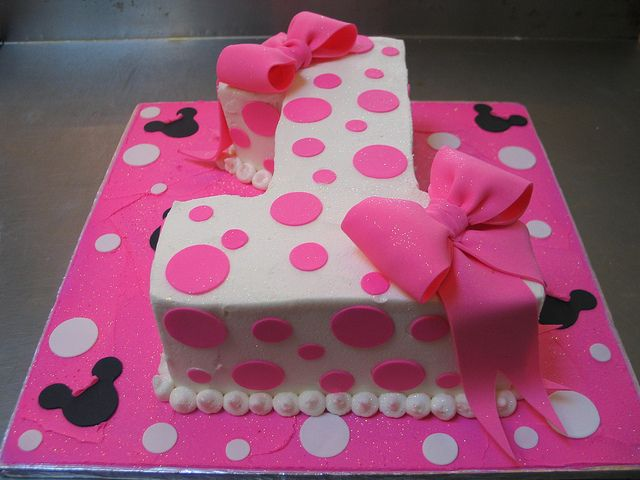 1 shaped Minnie Mouse themed cake iced in white butter icing