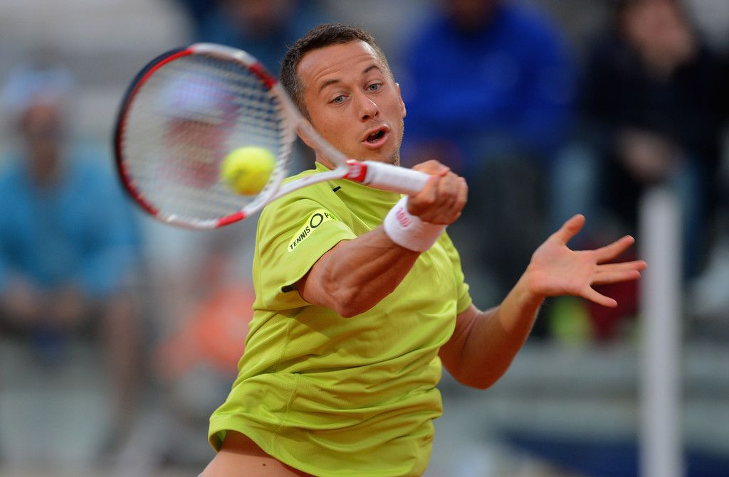 Philipp Kohlschreiber of Germany in action against Tommy Robredo of Spain during day 3 of the Internazionali BNL d'Italia 2014