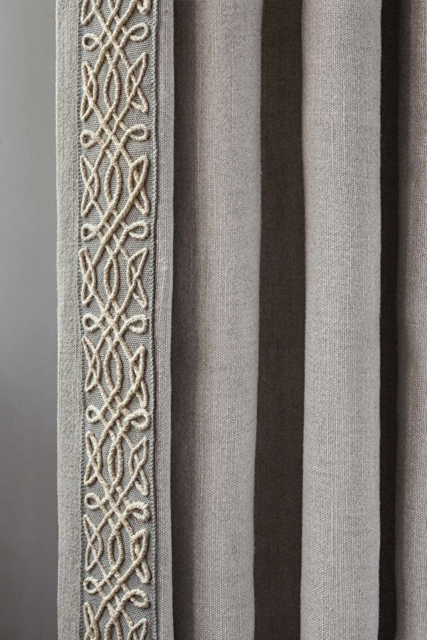 Neutral Linen Curtain With A Braid Trim On The Leading
