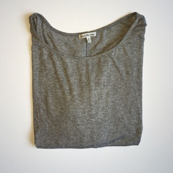 Charlotte Russe crop top Cute crop top. Fits like a crop top in the from and then hangs longer in the back. Mid length sleeve. Great condition worn once. Pair with skinny jeans and flats. Charlotte Russe Tops Crop Tops