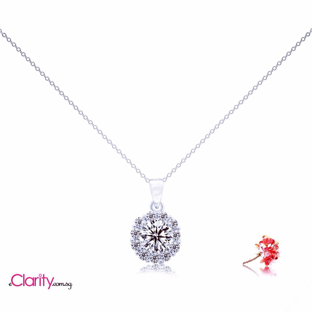 Diamond pendant setting scintillating with round brilliant