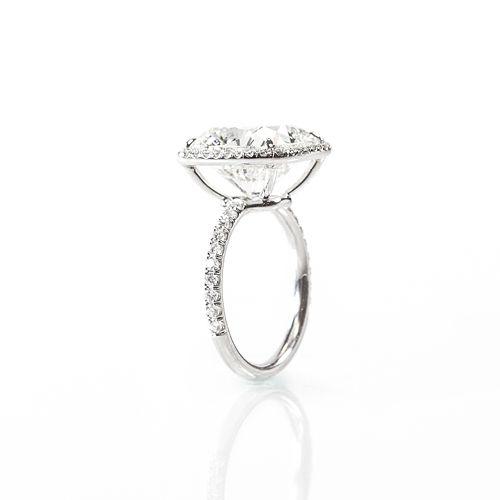 8.62 Cushion cut KSI2 set in platinum and Universal Diamonds classic halo setting