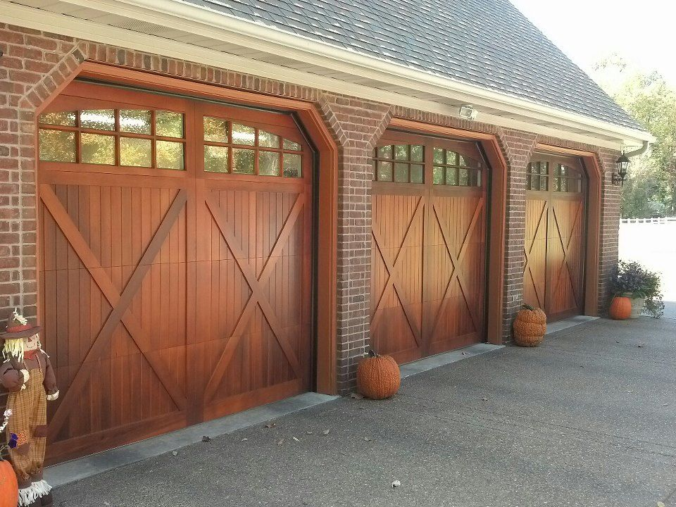 Wood Carriage House Garage Doors By C H I Www Chiohd Com Carriage Garage Doors Wooden Garage Doors