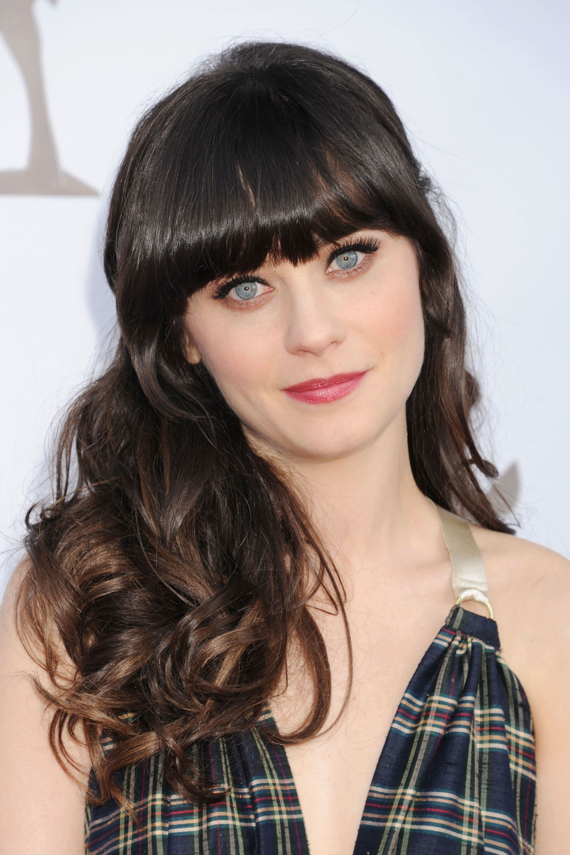 Give extra-long locks an instant update with freshly cropped fringe like Zooey Deschanel's. Tell your stylist to snip the center pieces so they fall right below your eyebrows, while the outer ones should be slightly longer. Getty Images -Cosmopolitan.com