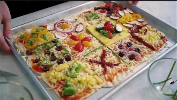 #Kid-Friendly Quilt #Pizza has a Square for Everyone | Kids can design their own quilt squares, then enjoy all the creativity in the final baked pizza quilt. Everyone gets the same amount of pizza -- with no fighting for the last slice!