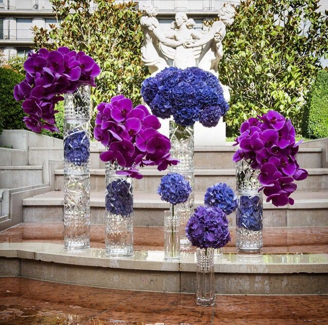 Purple and blue gorgeous flowers in stackable vases!!   #teamleatham
