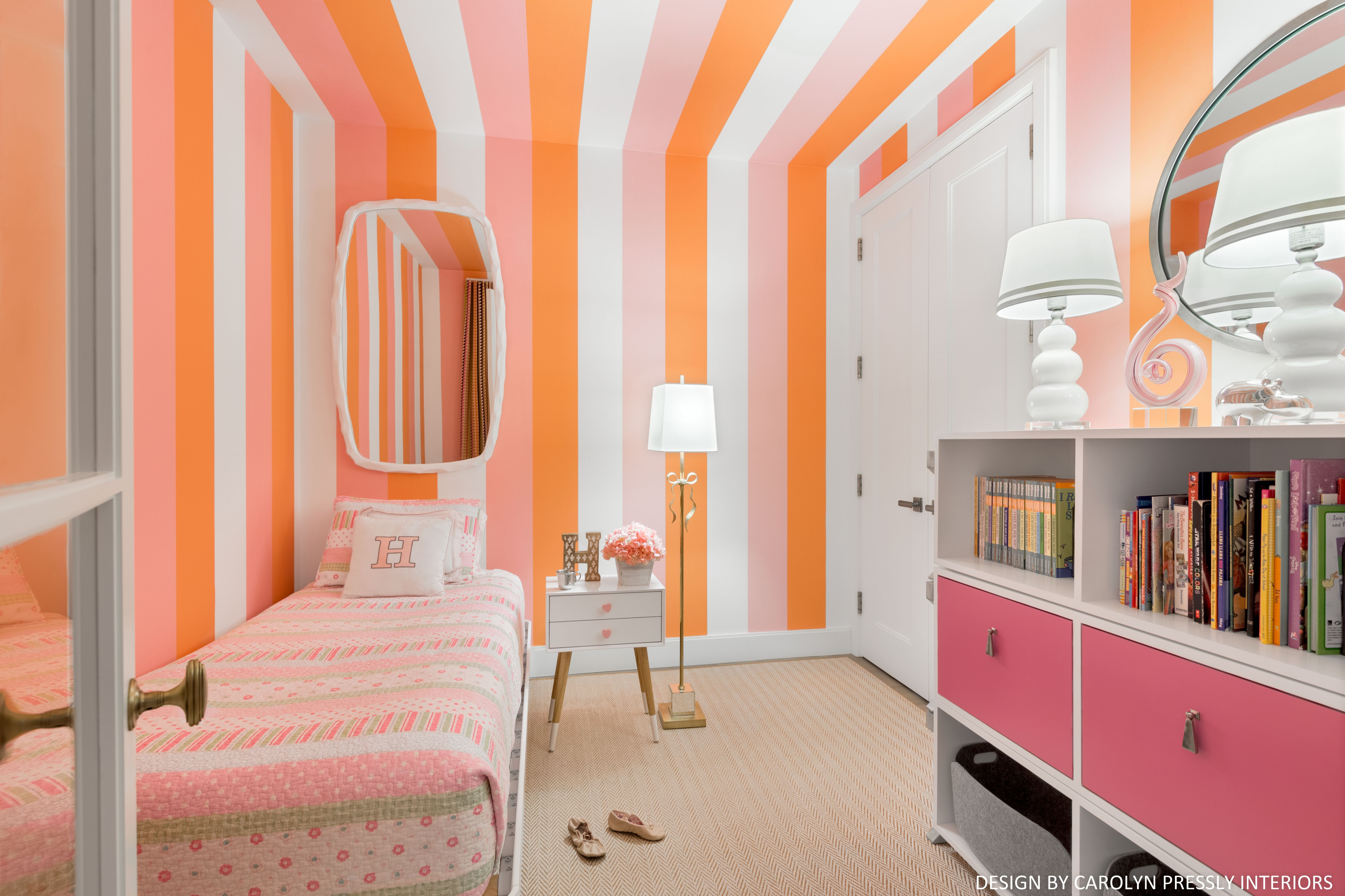 Bright pink and orange striped wallpaper. Ceiling