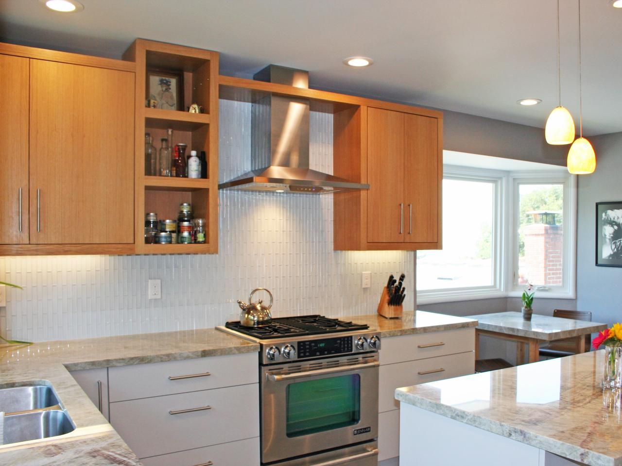 This glass tile backsplash completes the clean look of this