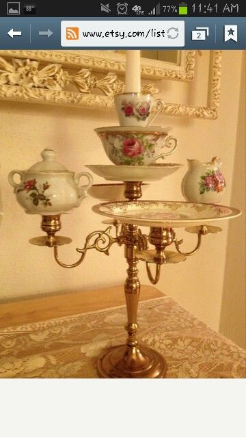 Buy old tea cups & plate at dollar store or goodwill - glue to candelabra for chips & dip for Beauty & The Beast shower inspiration