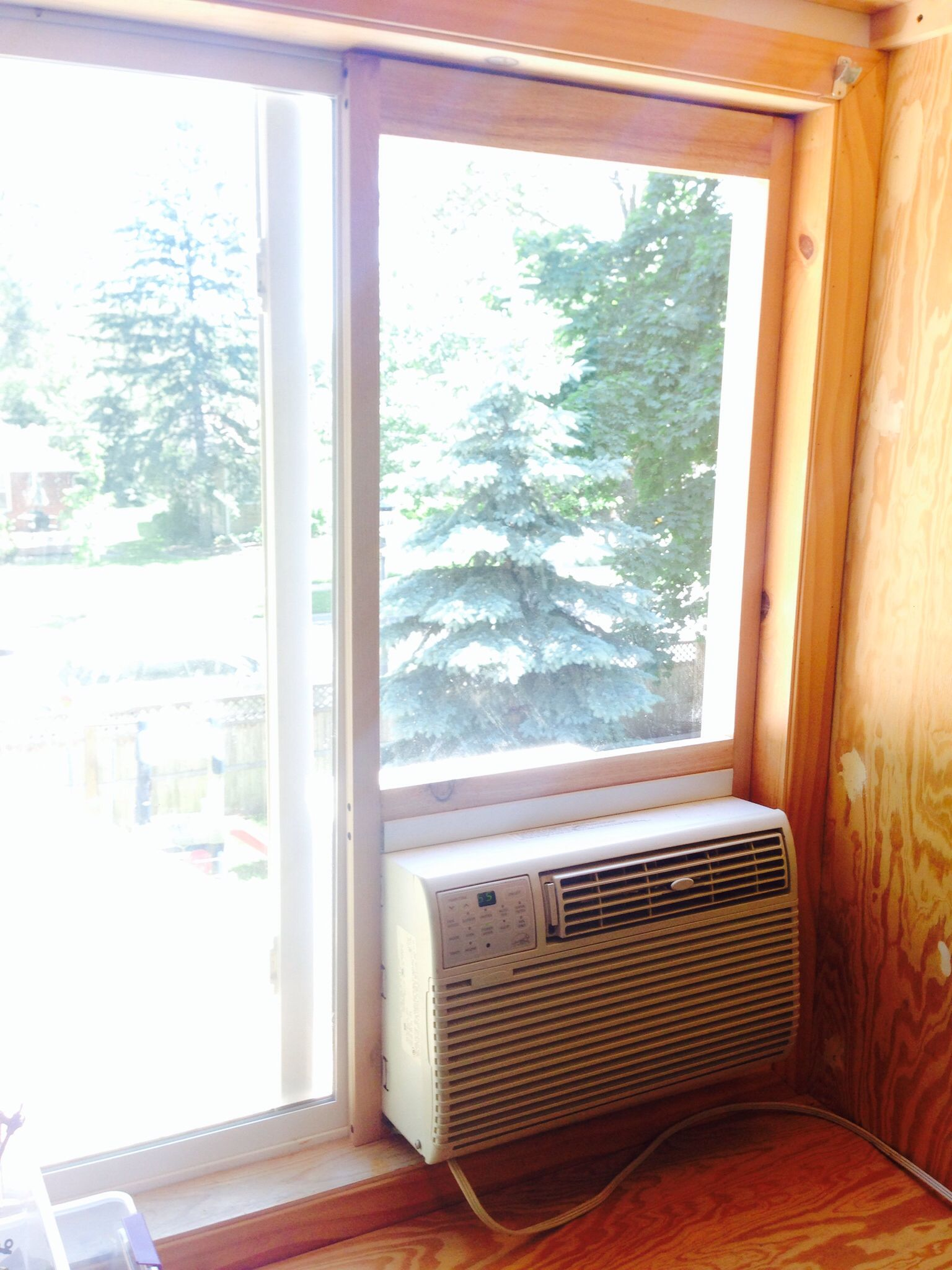 Air conditioner mount for sliding window home