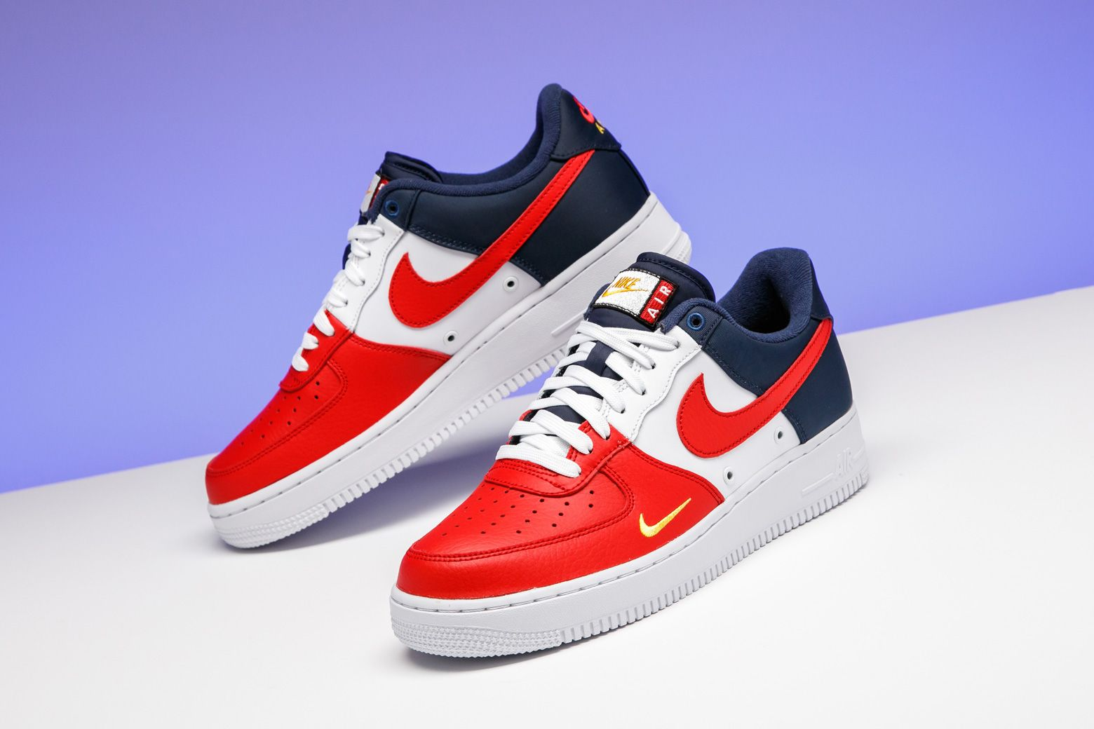 136a1b5be12 Nike dressed the Air Force 1 Low in a patriotic colorway with insane color  blocking and an offsetting mini-Swoosh.