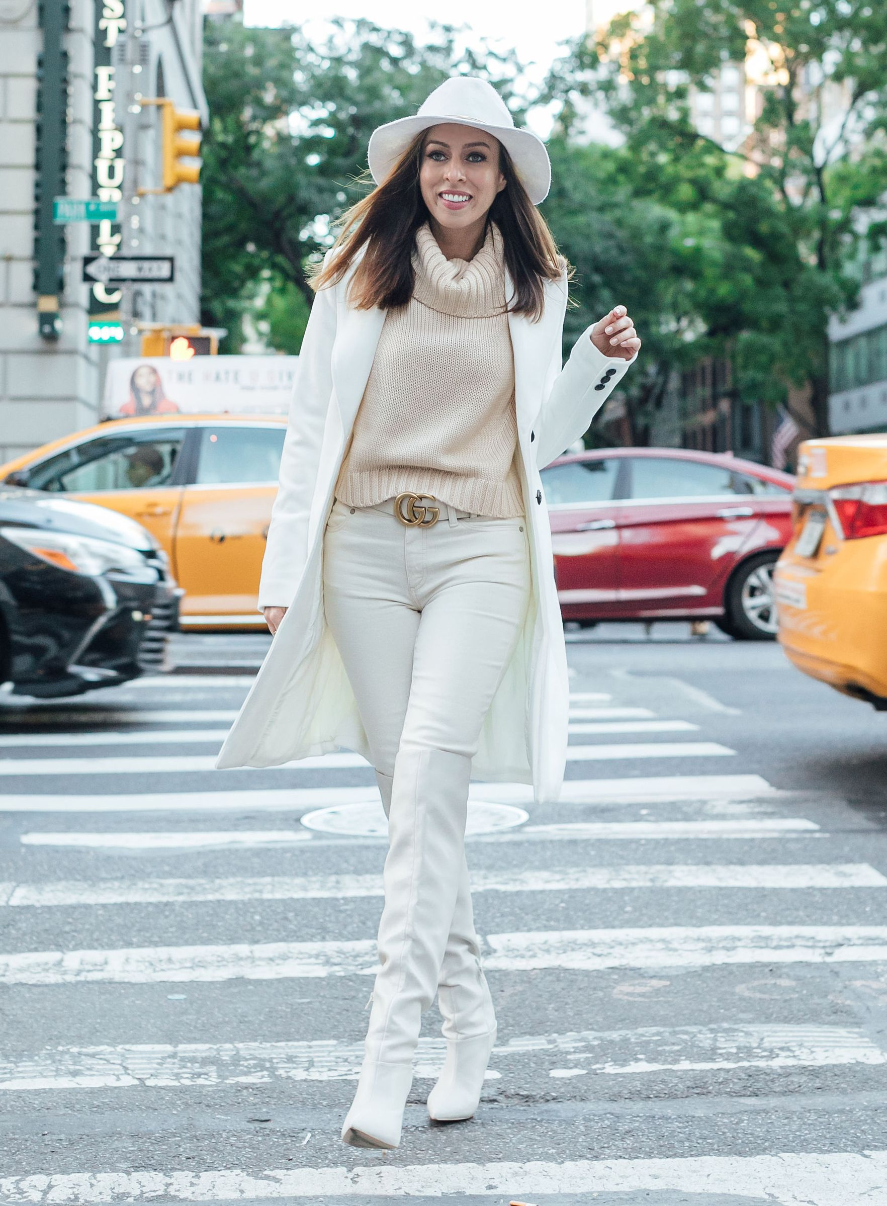 21fbecef5e4 Sydne Style shows how to wear winter white in white coat and jeans in new  york city  coats  white  boots  overthekneeboots  guccibelt  sydnesummer