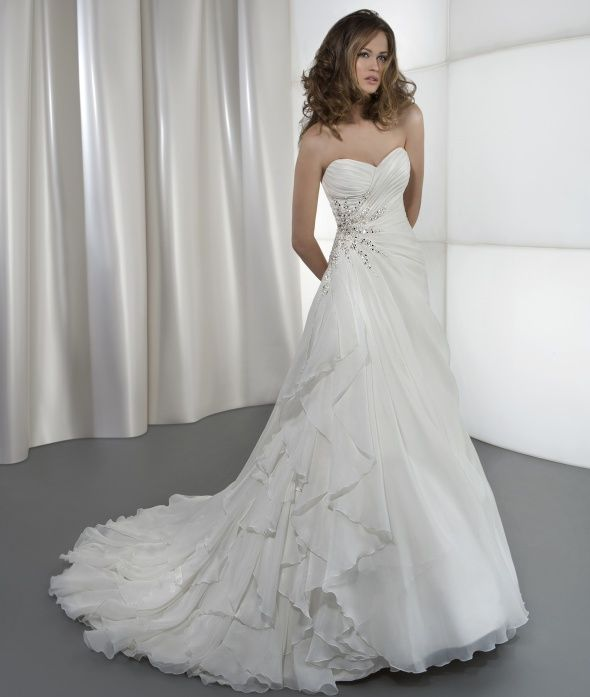 This Bridal Gown Posses Such A Wonderfully Simple Beauty Just Enough Sparkle And Light