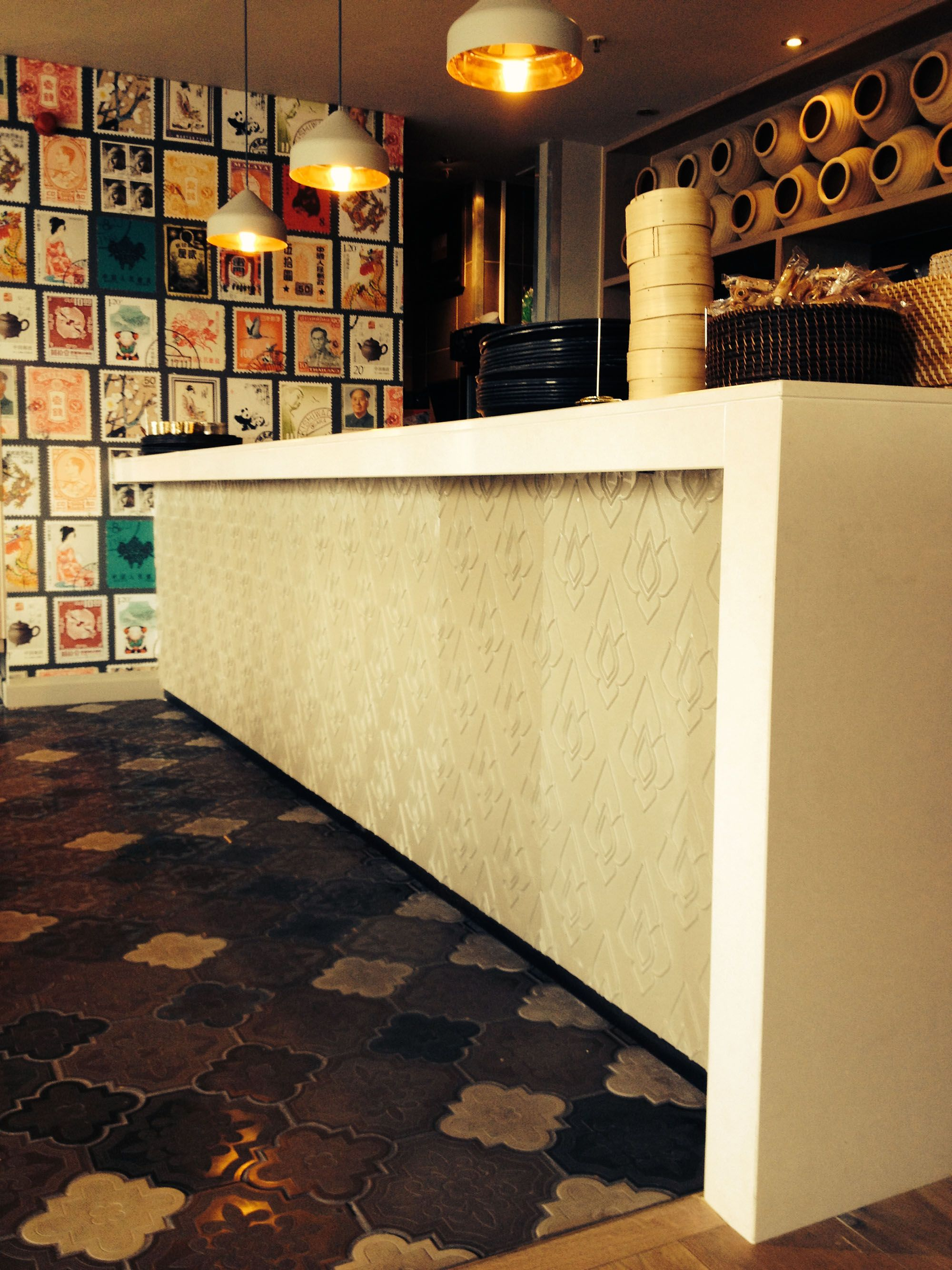 dim t restaurant, 3d embossed tiles for concrete bar front