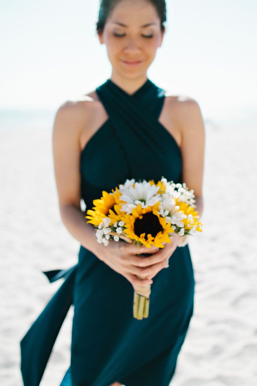 Tampa wedding bridesmaid in navy blue with yellow sunflower