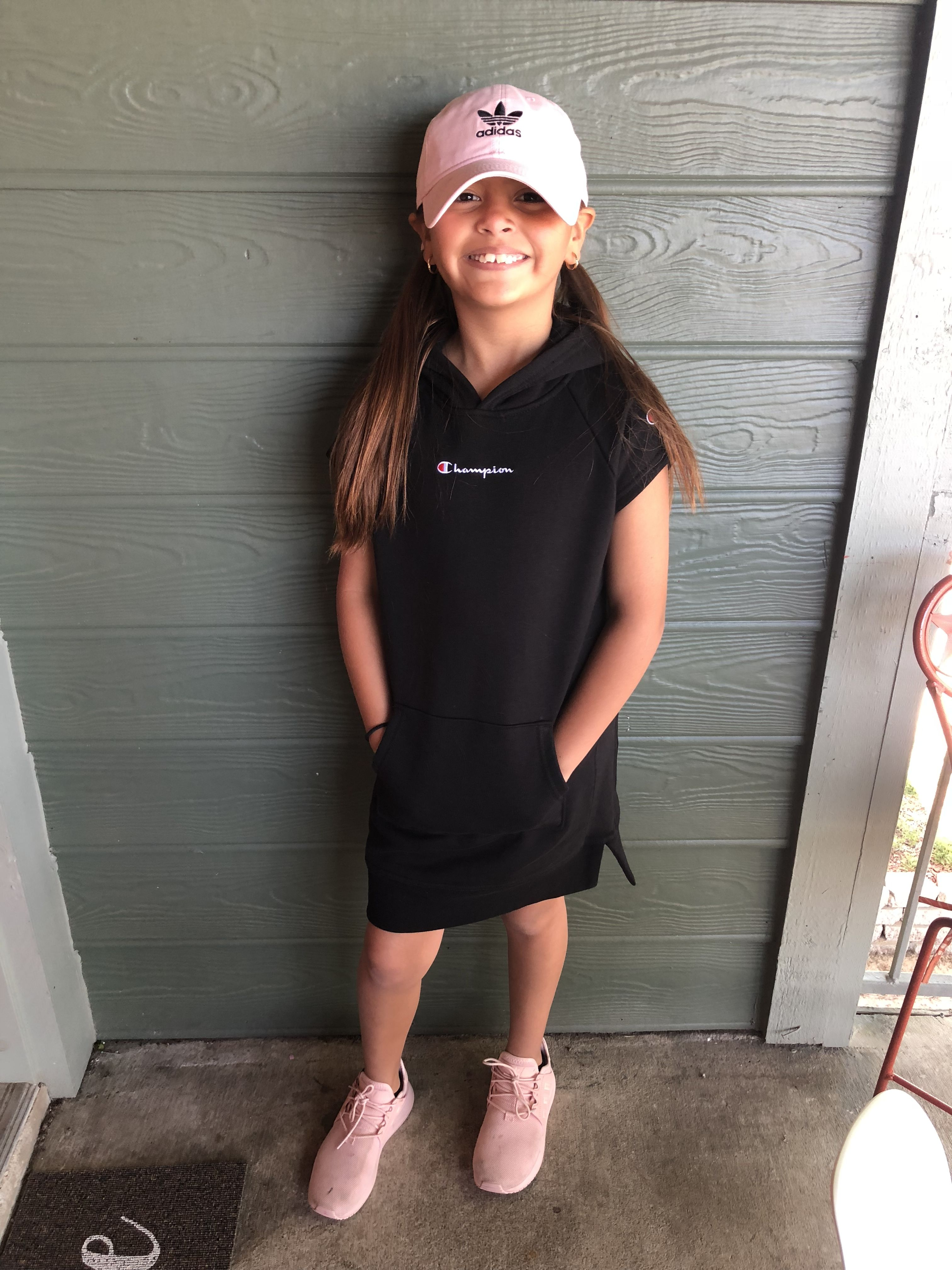 8b2a716cc46 Black champion sweater dress from Kids Footlocker paired with a pink adidas  hat and shoes
