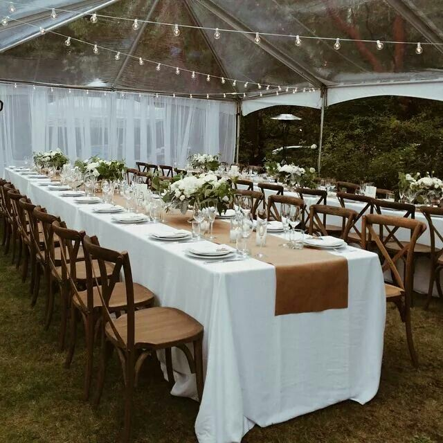 Long Harvest Tables With White Linens, Simple Vases, Wood Chairs And Kraft  Paper Runner
