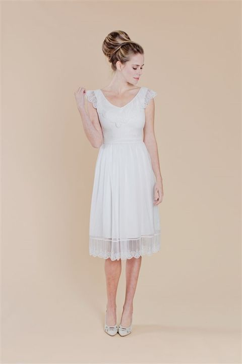 Are you looking for a reception dress to change into? This gorgeous a line has all the frills needed!