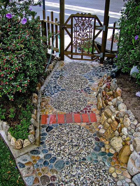 A path made of colorful river rocks like this would be a great and relatively easy diy project - River stone walkway ideas seven diy projects ...
