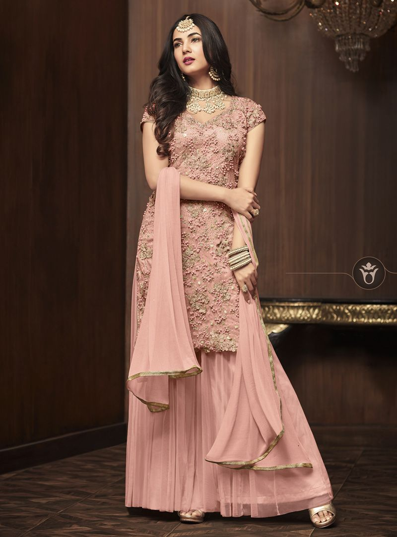 704cbfd043 Buy Sonal Chauhan Peach Net Sharara Style Suit 143194 online at lowest  price from huge collection of salwar kameez at Indianclothstore.com.