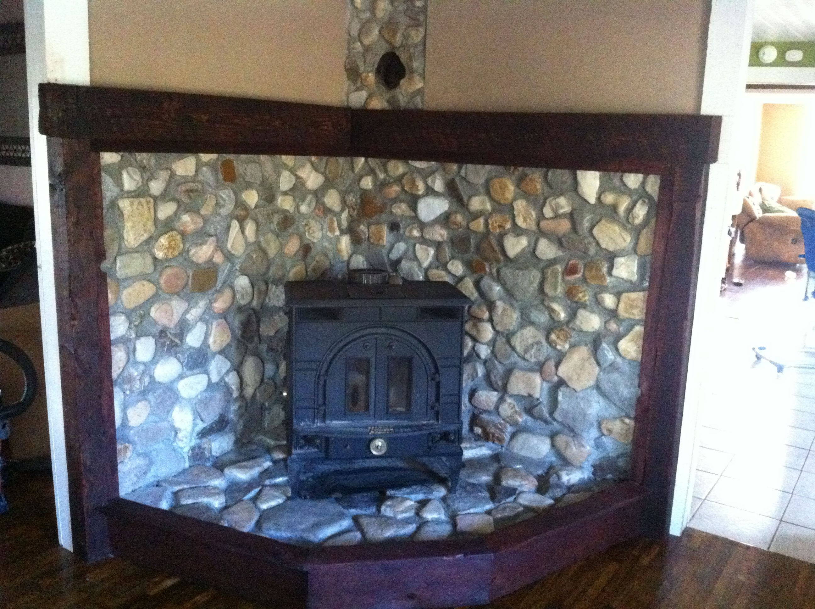 River rock wood stove surround and mantel project complete - Rockabilly mantel ...