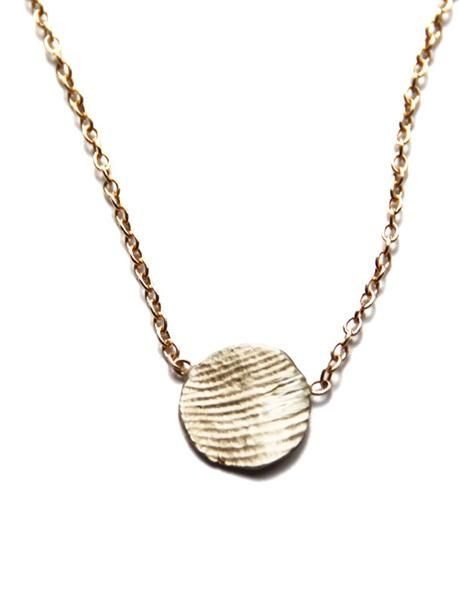 Jook and Nona - Tiny Print Necklace | VAULT    The Tiny Print Necklace Kit captures your loved one's fingerprint through an easy-to-follow mail-in impression packet. Each piece is individually crafted, cast and finished by hand once it is received.
