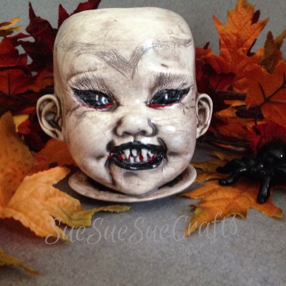 Get a vampire before Halloween, still time. Ceramic vintage doll head planter that is just a little creepy. Use this vampire planter for plants
