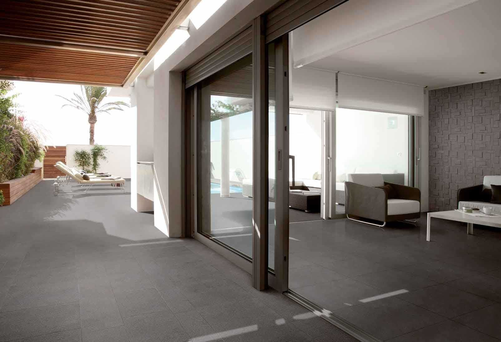 wall detail - floor moves from inside to outside giving illusion of larger space. Large glass doors