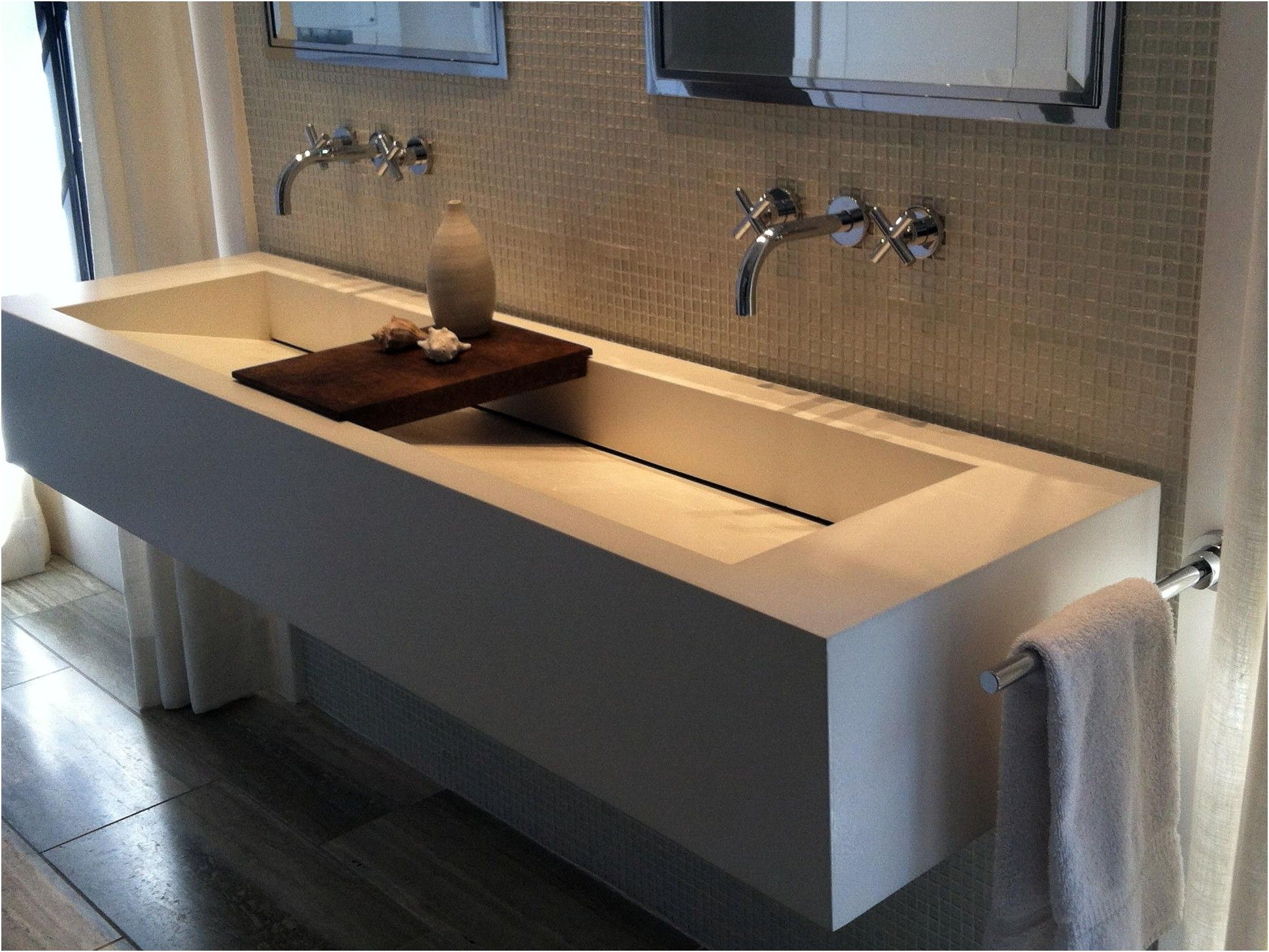 sophisticated white mercial trough sink with wooden soap dish from