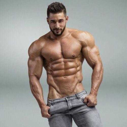 Sexy dude get his amazing body massaged