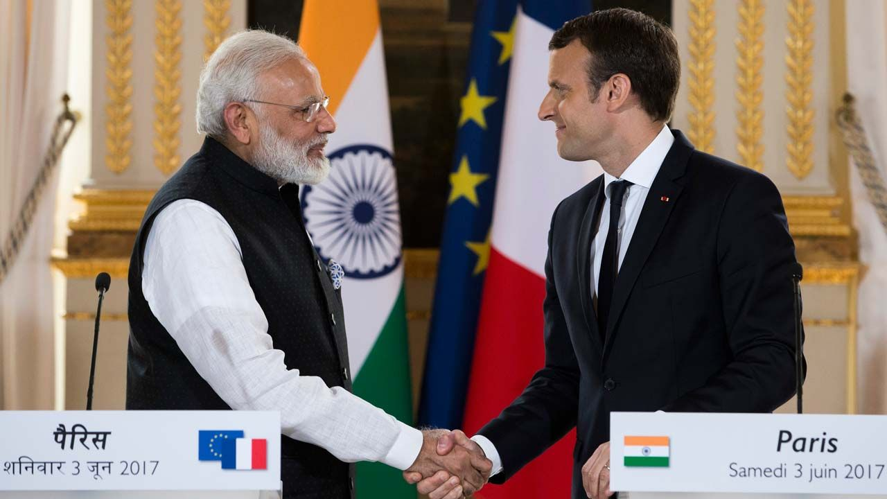India vows to 'go beyond' Paris accord, adding pressure on Trump   By AFP        France's President Emmanuel Macron (R) and India's Prime ...