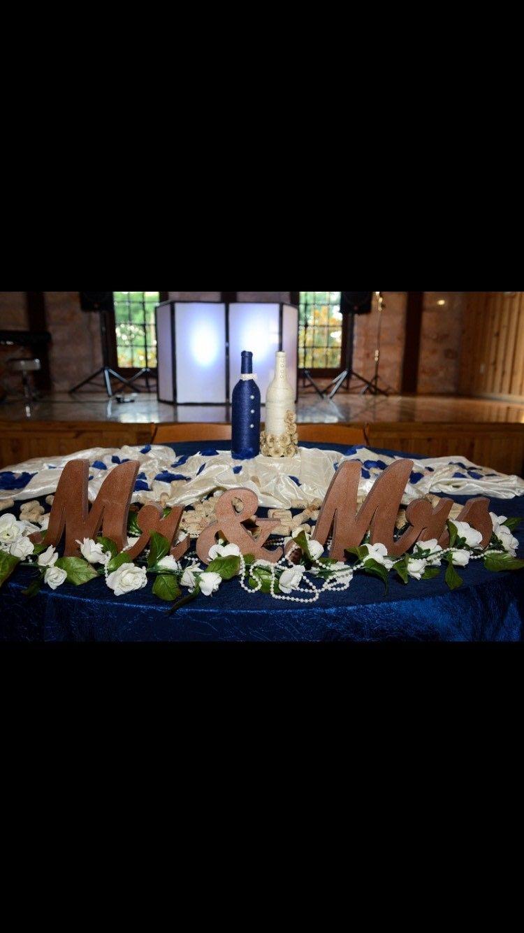 Blue and white wedding decor  rustic wedding sweetheart table  rustic wedding reception