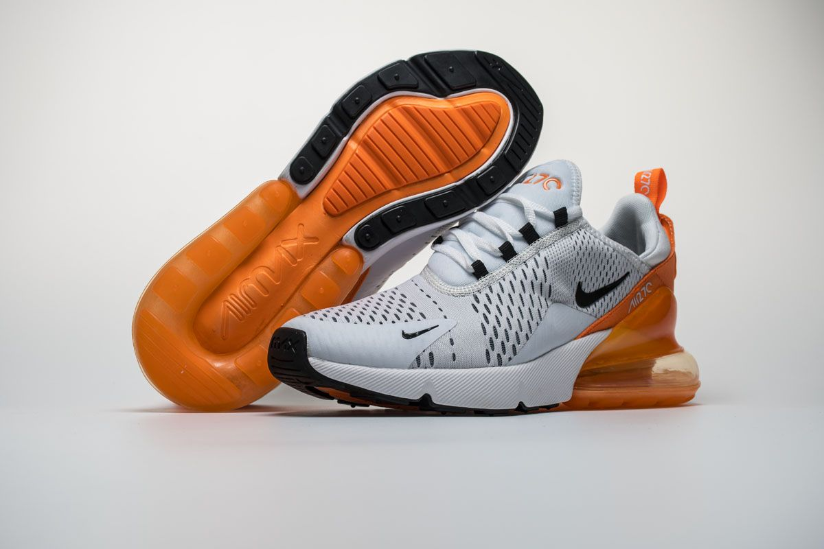 the latest e1e37 32914 Nike Air Max 270 White Orange Black Shoes4 Highlighted with a clean White  base while Black lands on the Nike Swoosh and lace loops.