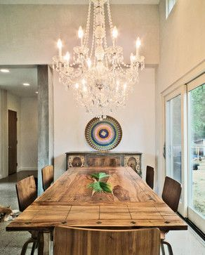 Dramatic chandelier over rustic table.. Love!