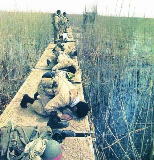 Iranian soldiers praying during the Iran-Iraq War