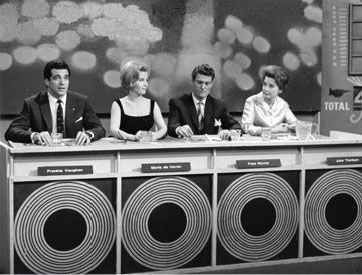 Jute Box Jury was a music panel show which ran from 1959 till 1967. Hosted by David Jacobs, it had different guests each week. Seen here with Frankie Vaughan on the panel.