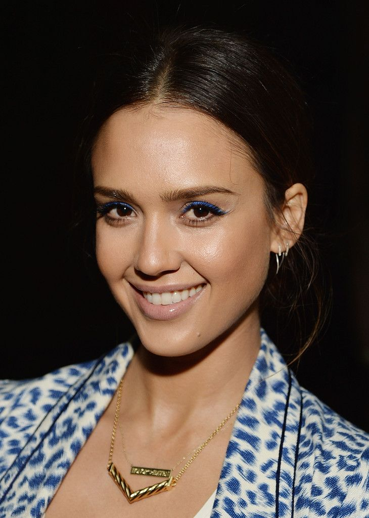 Jessica Alba's casual updo and electric blue eyeliner