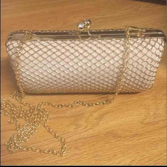 Beige and Gold Cross-Body Clutch Only been used once, Minor scratch (shown on picture), Silky interior, Bag Length: 7 in, Bag Height: 3 in. Bags Clutches & Wristlets
