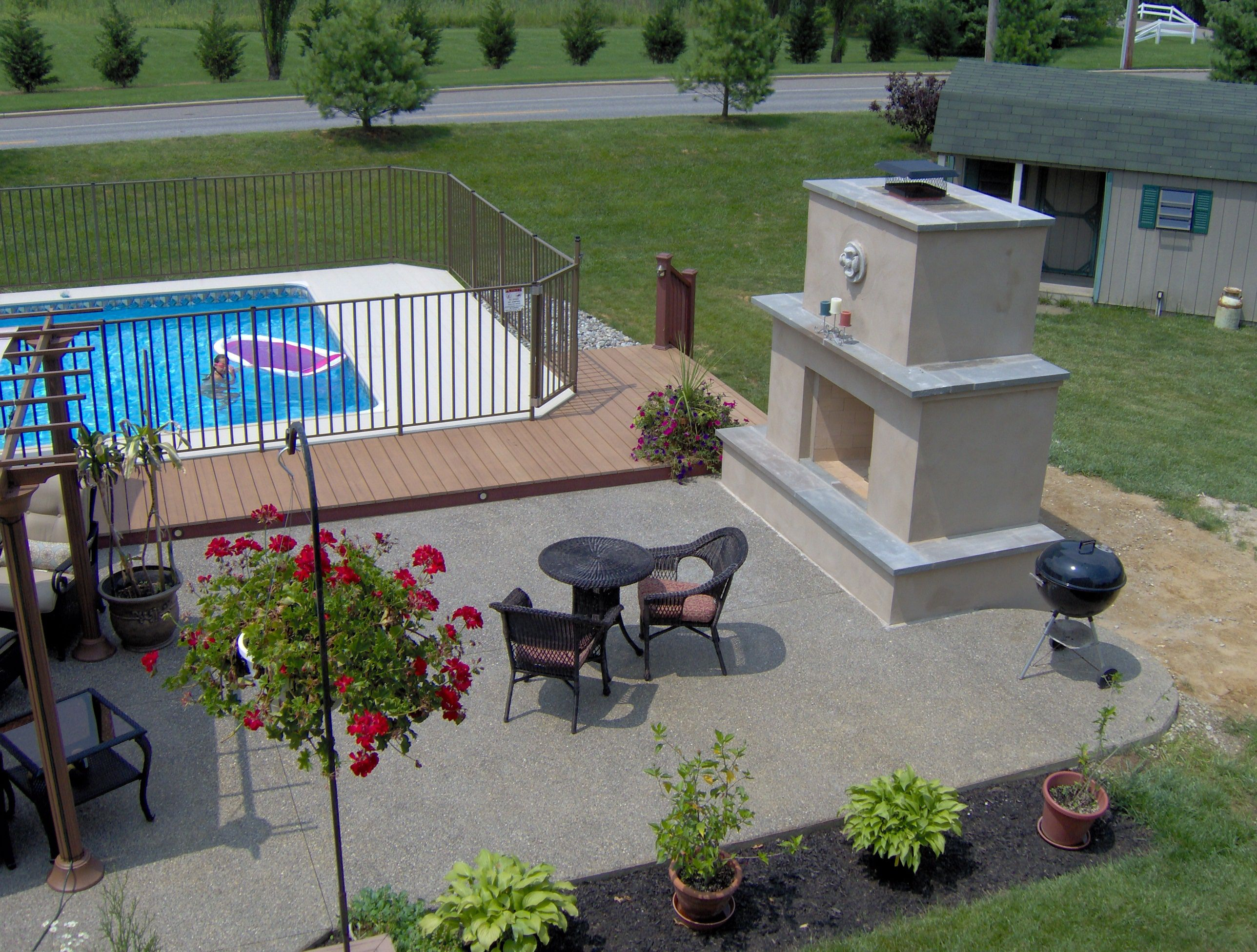 trex deck around above ground pool and patio create your space