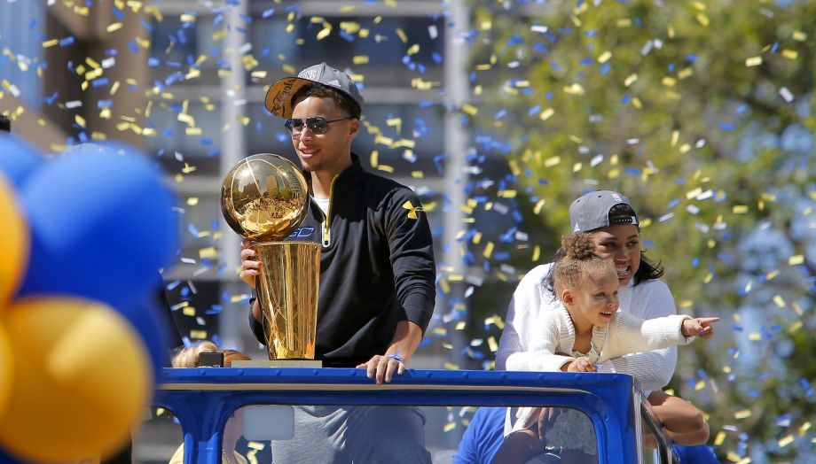 Stephen Curry Holding Trophy