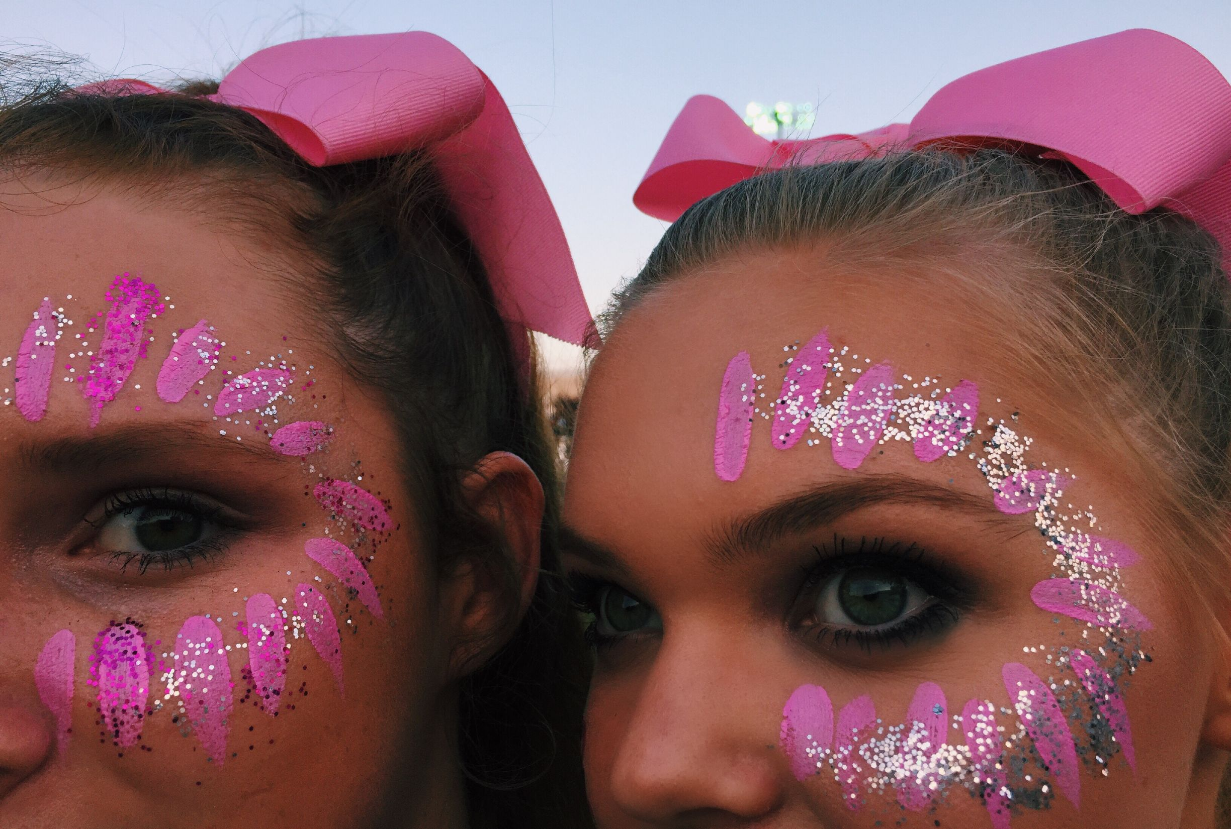 Face paint and glitter for the big Pink Out football game