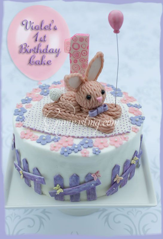 A cute gumpastefondant knitted bunny topper for a Birthday cake