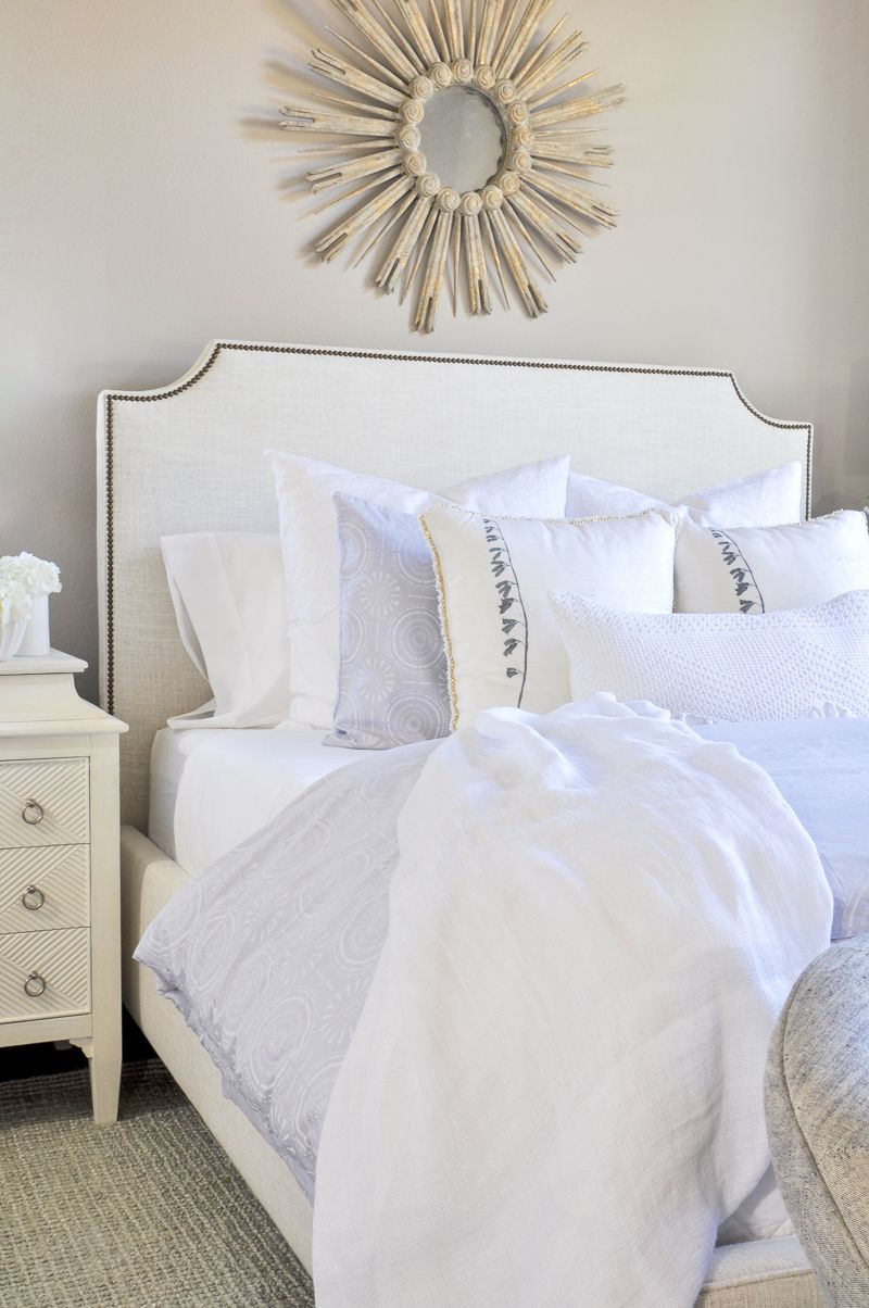 Beautiful Layered Bed With White Bedding And Sheets