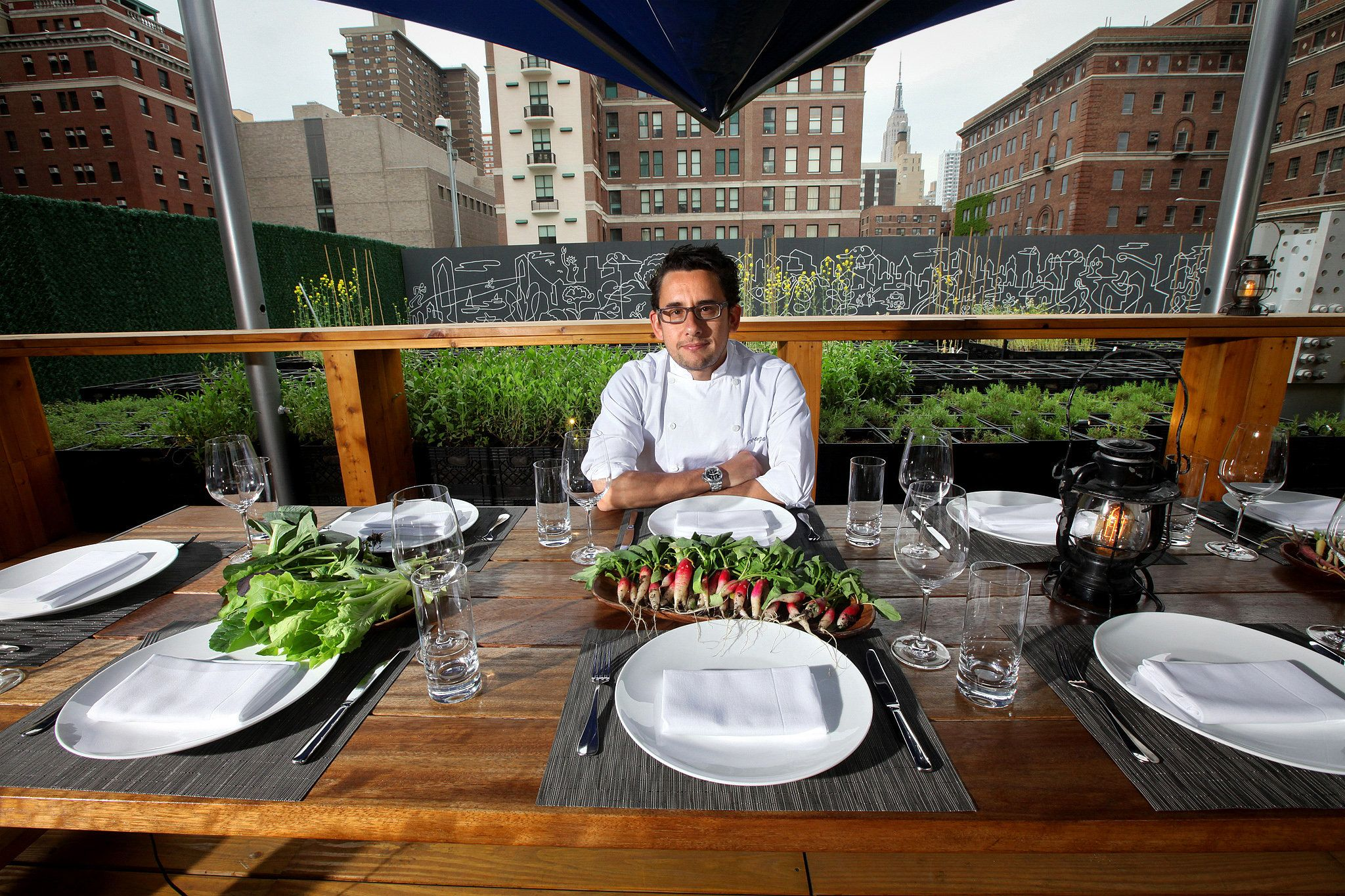 Talk about locavores: the restaurant Riverpark serves vegetables it grows, at an outdoor table.
