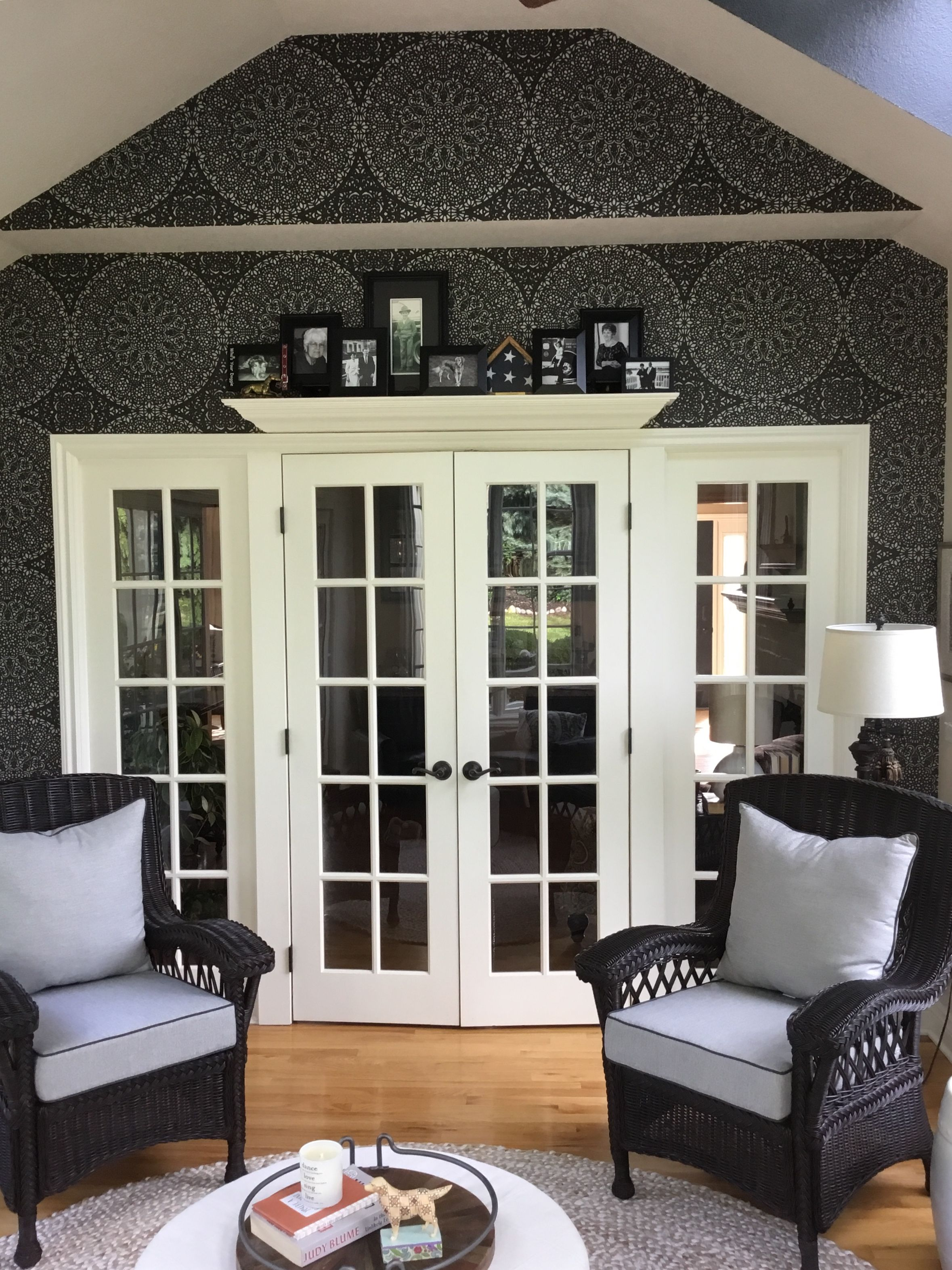 Sunroom with wallpaper accent wall.  Sunroom decorating