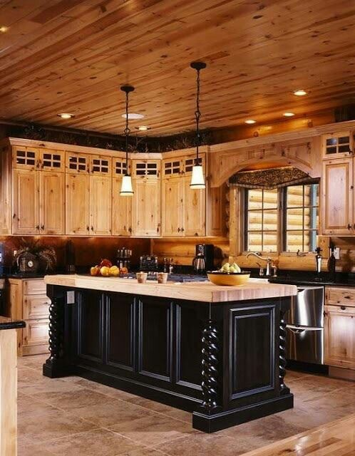 Log cabin kitchen look at the beautiful ceiling also