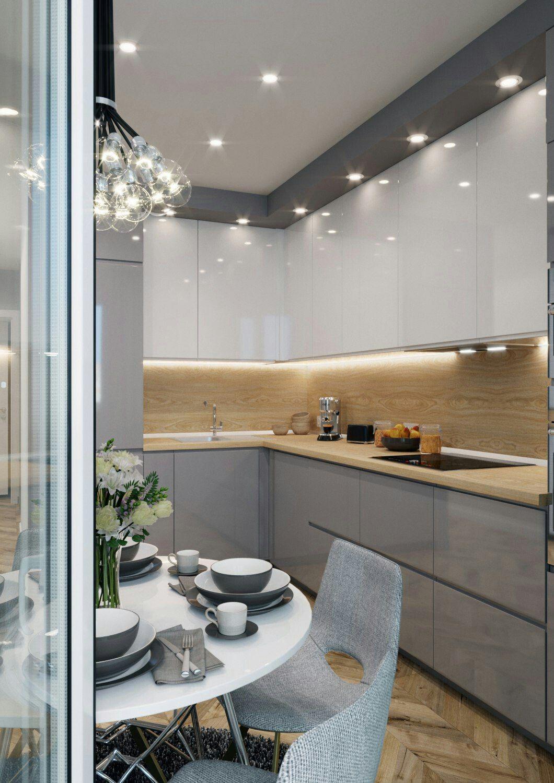 Cucine Moderne Bianche Effetto Legno.Un Piano Ed Uno Schienale Effetto Legno Danno Carattere Al